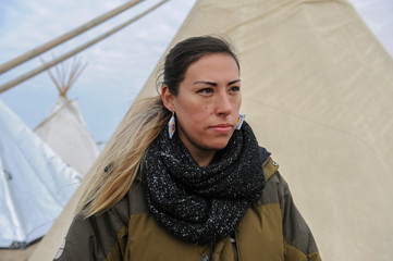 Vanessa Castle from the Lower Elwha Klallam tribe poses for a photograph in an encampment during a protest against plans to pass the Dakota Access pipeline near the Standing Rock Indian Reservation, near Cannon Ball, North Dakota, U.S.