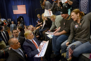 Trump signs autographs after speaking at a rally in Reno