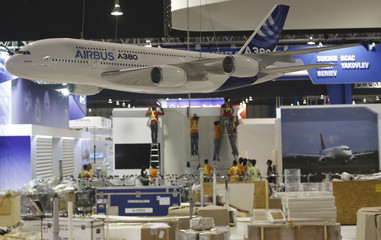Workers set up exhibition venue of Singapore Airshow
