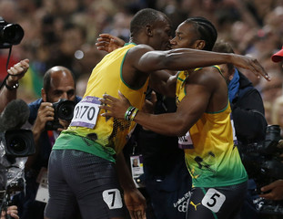 Jamaica's Usain Bolt hugs second-placed compatriot Yohan Blake after winning the men's 100m final during the London 2012 Olympic Games at the Olympic Stadium