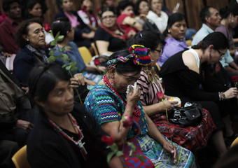 An indigenous woman cries before the sentence is read during a hearing at the Supreme Court in Guatemala City
