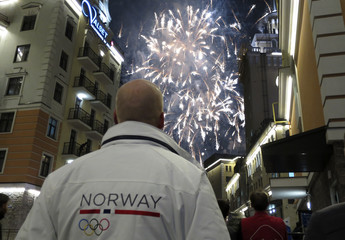 People watch fireworks during a opening ceremony of the Sochi 2014 Winter Olympics in Rosa Khutor
