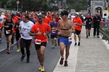 Athletes run outside Jerusalem's Old City as they participate in the sixth international Jerusalem Marathon