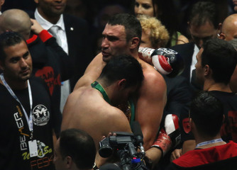 Klitschko embraces defeated challenger Charr after their WBC heavyweight title fight in Moscow