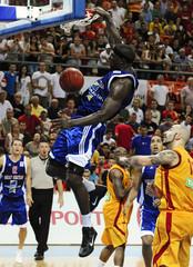 Bonsu of Britain dunks during their men's European Championship 2011 qualification basketball game against Macedonia in Skopje