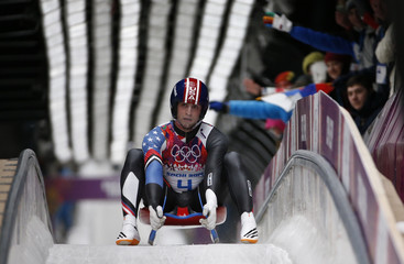 Mazdzer of the U.S. comes to a stop after a run in the men's singles luge competition at the 2014 Sochi Winter Olympics