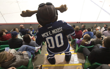 Winnipeg Jets mascot Mick E. Moose watches the action during Jets NHL pre-season hockey game against the Washington Capitals in Belleville