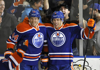 Edmonton Oilers' Hall celebrates one of his three goals against the Vancouver Canucks with Potter during their NHL hockey game in Edmonton