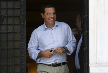Tsipras leaves his office at Maximos Mansion in Athens
