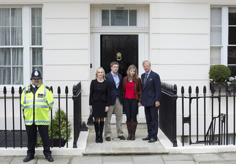 Mark Thatcher poses with his wife Sarah and his children Michael and Amanda, at the home of former British prime minister Margaret Thatcher, in London
