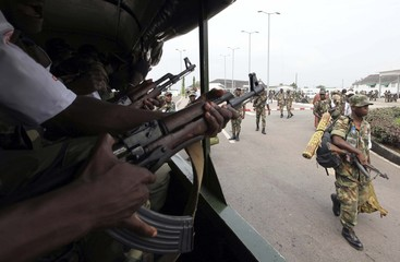 Soldiers prepare as they are deployed to secure the presidential election process, at the army headquarters in Abidjan