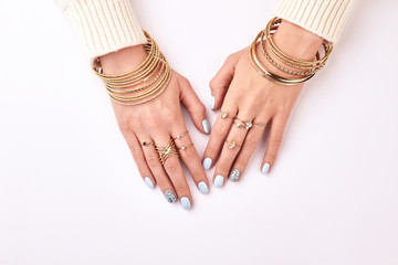 Wall Mural - Beautiful female hands in jewelry.