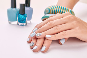 Fototapete - Beautiful new women's manicure and nail polishes for manicure.