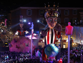 The float of the King of Carnival is paraded through the crowd during the Carnival parade in Nice
