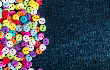 Multi colored buttons on a denim background