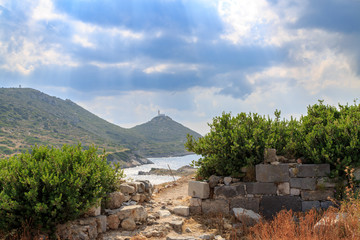 Lighthouse between ancient city remmants in Knidos, Datca, Turkey