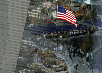 A U.S. flag flies over ground zero before the start of the ceremony marking the 10th anniversary of the 9/11 attacks on the World Trade Center, in New York