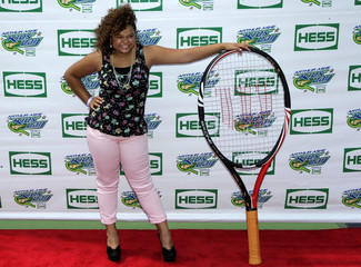 Singer Rachel Crow poses for a picture during the Arthur Ashe Kids' Day ahead of the 2012 U.S. Open tennis tournament in New York