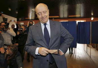 French politician Alain Juppe, current mayor of Bordeaux, and member of the conservative Les Republicains political party, votes in the first round of the French center-right presidential primary election in Bordeaux