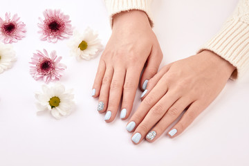 Fototapete - Manicure and chrysanthemums.