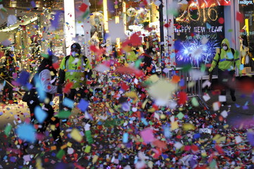 Workers clean up confetti after New Year's celebrations in Times Square
