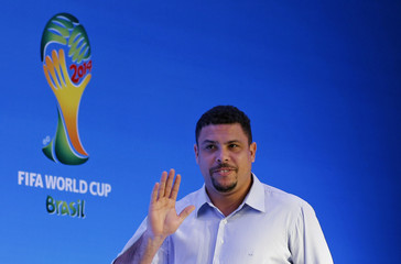 Ronaldo waves as he arrives at a news conference in Sao Joao da Mata