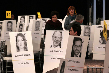 Photos are pictured on seats indicating where celebrities will be seated during tomorrow's Screen Actors Guild Awards at the Shrine Auditorium in Los Angeles