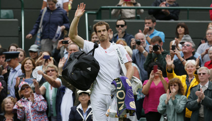 Andy Murray of Britain celebrates after defeating Marin Cilic of Croatia in their men's singles tennis match at the Wimbledon tennis championships in London