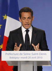 France's President Sarkozy delivers a speech after a meeting focused on security at the Seine-Saint-Denis prefecture in Bobigny