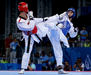 Taghizade of Azerbaijan and Robak of Poland fight during their men's 68Kg taekwondo gold medal fight at the 1st European Games in Baku