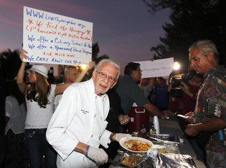 Arnold Abbott, of  Love Thy Neighbor Fund, Inc. whichs feed and educate the homeless, serves food in Fort Lauderdale