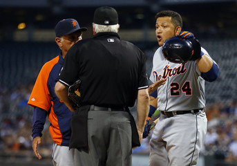 Tigers third baseman Cabrera yells at home plate umpire Gorman as manager Leyland gets between them, after Cabrera was ejected in the first inning during MLB game against the White Sox in Chicago