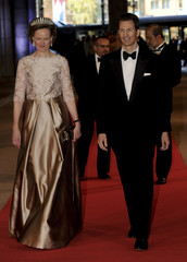 Crown Prince Alois of Liechtenstein and Princess Sophie arrive at a gala dinner organised on the eve of the abdication of Queen Beatrix of the Netherlands in Amsterdam