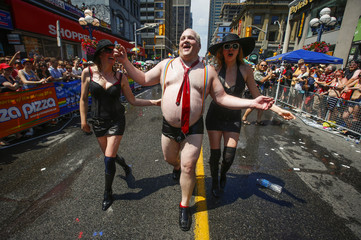 "A man dressed to mock Toronto Mayor Rob Ford takes part in the"" WorldPride"" gay pride Parade in Toronto"