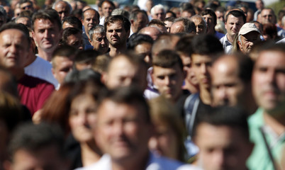 Local Serbs attend a protest in the village of Zupce near the town of Zubin Potok