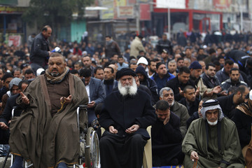 Shiite Muslims attend Friday prayers in Baghdad Sadr City
