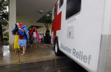 Evacuees pass by a Red Cross Disaster Relief van at a school after a train derailment near Maryville