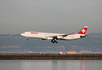 A Swiss International Air Lines Airbus A340 lands at San Francisco International Airport, San Francisco