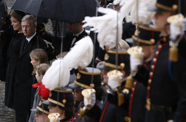 Belgium's King Philippe and Queen Mathilde arrive at Saint-Gudule cathedral to attend a funeral service for Belgium's Queen Fabiola in Brussels