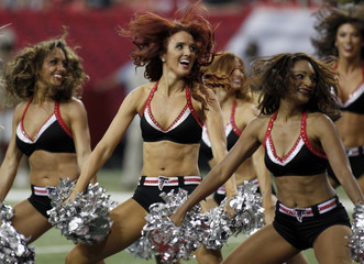 Atlanta Falcons cheerleaders perform in the second half of their NFL football game against the St. Louis Rams in Atlanta