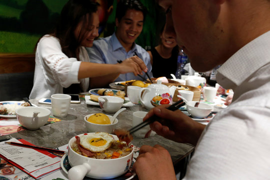 Customers enjoy a meal at Dim Sum Icon restaurant in Hong Kong