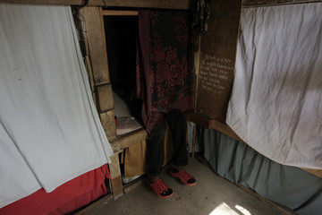 Inmate sits on his bed at the jail where six crew members of Florida-based shipwreck salvage company Aqua Quest International have been held for a month, in Puerto Lempira