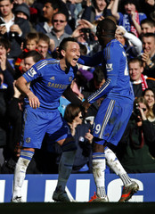Chelsea's John Terry celebrates his goal against Brentford with Demba Ba during their FA Cup fourth round replay soccer match at Stamford Bridge in London