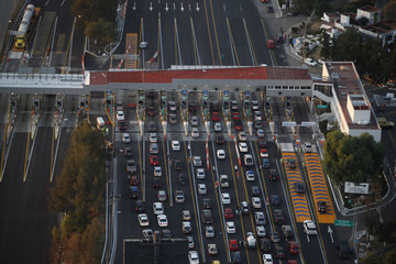 Cars form at toll booths to leave the city over Easter holidays in Mexico City