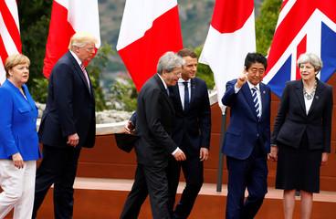 Germany's Chancellor Angela Merkel, U.S. President Donald Trump, Italian Prime Minister Paolo Gentiloni, France's President Emmanuel Macron, Japan's Prime Minister Shinzo Abe and Britain's Prime Minister Theresa May attend at the G7 summit in Taormina