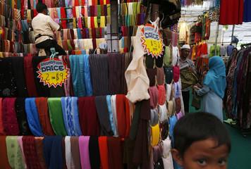 A woman shops for scarves at a Hari Raya bazaar ahead of Eid al-Fitr in Singapore