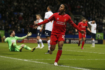 Liverpool's Raheem Sterling celebrates after scoring during their FA Cup fourth round replay soccer match against Bolton Wanderers at the Macron Stadium in Bolton