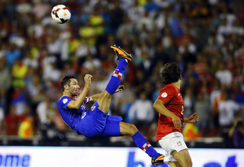 Croatia's Srna kicks the ball past Serbia's Markovic during their 2014 World Cup qualifying soccer match in Belgrade