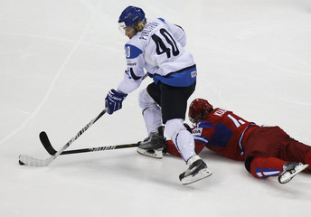 Russia's Kulikov is checked by Finland's Pihlstrom during their qualifying round game at the Ice Hockey World Championships in Bratislava