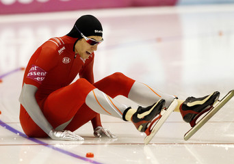 Norway's Even Johansen sits on the ice after falling during the men's World Sprint Speed Skating Championships in Heerenveen